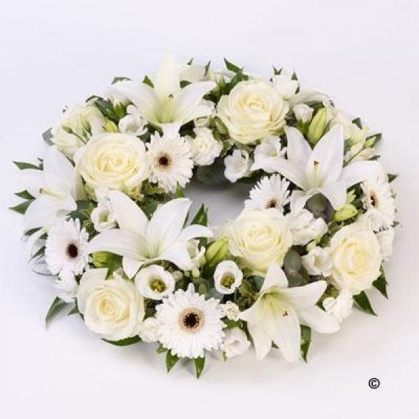 Oval-Centerpiece A set of white roses